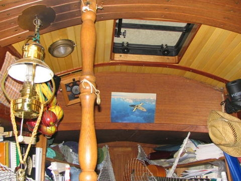 Yellow-ceder ceiling, and teak athwartships.